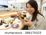 woman enjoy sushi at japanese... | Shutterstock . vector #388170325