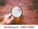 Hand Holding A Glass Of Beer O...
