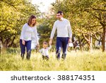 parents holding hands of their... | Shutterstock . vector #388174351