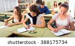 students sitting in classroom... | Shutterstock . vector #388175734