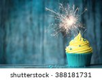 cupcake with yellow buttercream ... | Shutterstock . vector #388181731