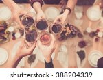 Friends Clinking Glasses Above Dinner - Fine Art prints