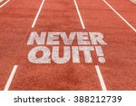 Small photo of Never Quit written on running track