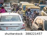 Small photo of THANJAVUR, INDIA - FEBRUARY 03: Indian riders ride motorbikes on busy road on February 03, 2012 in Thanjavur, India. Motorbike is the most favorite vehicle and most affordable for India.