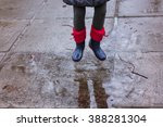 rain time.  jump in the puddle... | Shutterstock . vector #388281304