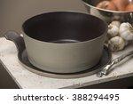 an empty beige flat bottom soup ...
