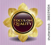 focus on quality gold badge   Shutterstock .eps vector #388359004
