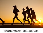 group of young people runs at... | Shutterstock . vector #388503931