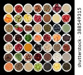 Small photo of Large health and superfood collection in porcelain crinkle bowls over black background. High in vitamins and antioxidants.