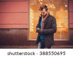 stylish man in a coat with a... | Shutterstock . vector #388550695