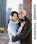 portrait of couple embracing... | Shutterstock . vector #388560559