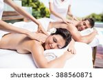 relaxed young couple receiving...   Shutterstock . vector #388560871