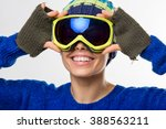 young woman with ski goggles ... | Shutterstock . vector #388563211