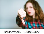 portrait of young woman showing ... | Shutterstock . vector #388580329