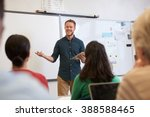 male teacher listening to... | Shutterstock . vector #388588465