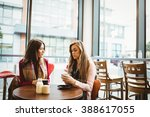friends having a cup of coffee... | Shutterstock . vector #388617055