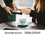 woman paying with mobile phone... | Shutterstock . vector #388628569