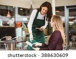 smiling waitress taking an... | Shutterstock . vector #388630609