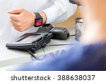 midsection of customer paying... | Shutterstock . vector #388638037