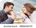 couple looking at each other... | Shutterstock . vector #388640419