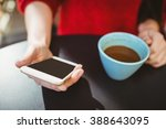 woman using her smartphone in... | Shutterstock . vector #388643095