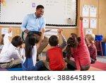 elementary school kids sitting...   Shutterstock . vector #388645891
