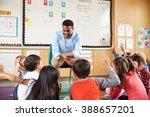 elementary school kids sitting... | Shutterstock . vector #388657201
