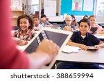teacher using tablet computer... | Shutterstock . vector #388659994