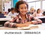 schoolgirl at desk in... | Shutterstock . vector #388664614