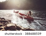 young people kayaking in a lake.... | Shutterstock . vector #388688539