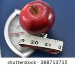apple on weighing machine with...   Shutterstock . vector #388713715