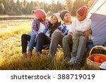 parents with children camping... | Shutterstock . vector #388719019