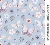 Stock vector seamless pattern with flying butterflies and flowers in blue mat background vector illustration 388729795
