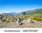 A Young Tourist Places Rocks A...