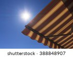sun shade  with blue sky in the ... | Shutterstock . vector #388848907