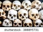 Small photo of Pile of Skeleton Heads laid on top of each other, Killing Fields, Phnom Penh.