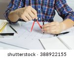 hands of architects working on... | Shutterstock . vector #388922155