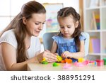 child girl and woman playing... | Shutterstock . vector #388951291