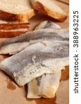 Small photo of Pickled herring and bread. Salted, soused skinless fillets of fish Clupea.