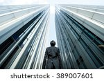 businessman looking up at the... | Shutterstock . vector #389007601