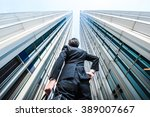 businessman looking up at the... | Shutterstock . vector #389007667