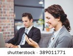 close up of businesswoman using ... | Shutterstock . vector #389011771