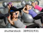 Group Of Gym People Exercising...