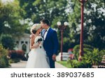 beautiful wedding couple... | Shutterstock . vector #389037685