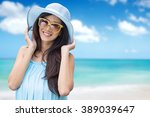 happy young woman on the beach  ... | Shutterstock . vector #389039647