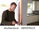 man checking mobile phone as he ... | Shutterstock . vector #389059615