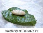 Stone on a leaf - stock photo