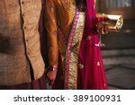 rich indian couple at the... | Shutterstock . vector #389100931