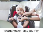 portrait of a mother securing...   Shutterstock . vector #389102749