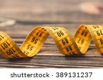 curved measuring tape. | Shutterstock . vector #389131237